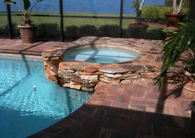 natural-stone-spa-runs-into-pool