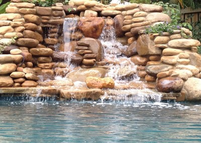 Natural-Stone-waterfall-into-pool